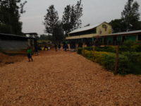 This is a view of our Assembly Field at W.A. You can also see our School kitchen on the left.
