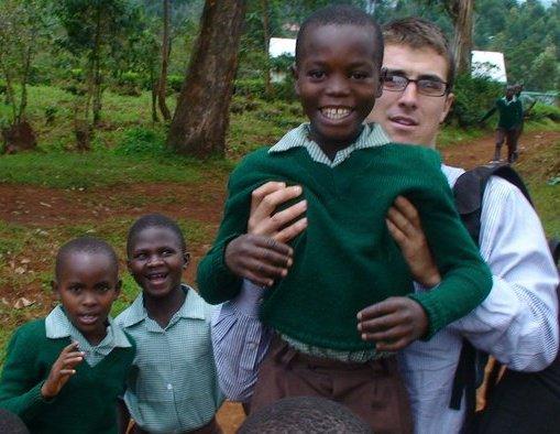 Ben Cobb with children at Wisdom Academy